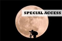 Photographer silhouette against a full moon, photo SantiPhotoSS/Shutterstock
