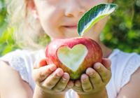 Girl holding apple from Field Trip in-a-Box, photo Tatevosian Yana/Shutterstock