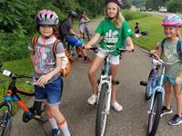 Campers biking around the Arboretum during Summer Day Camp