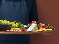 chef holding party platter, photo Fortyforks/shutterstock