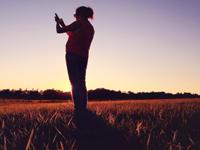 iphone photographer at sunset taking photo of beautiful light, photo Eric Mueller